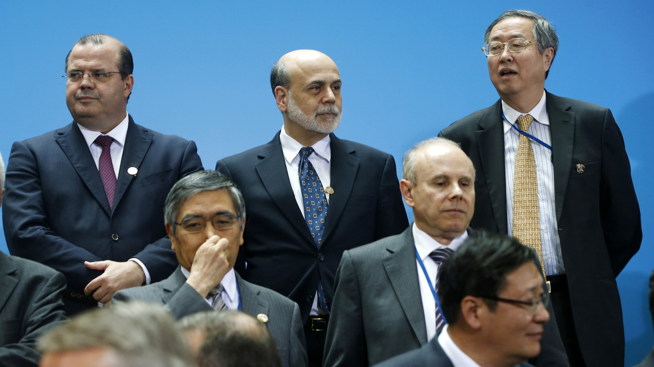 Federal Reserve Chairman Ben Bernanke, center, stands with China Central Bank Gov. Zhou Xiaochuan, right, and Brazil Central Bank Gov. Alexandre Tombini during a group photo of the G20 finance ministers and central bank governors on the sidelines of their meeting at World Bank Group International Monetary Fund Spring Meetings in Washington, Friday, April 19, 2013. (AP Photo/Charles Dharapak