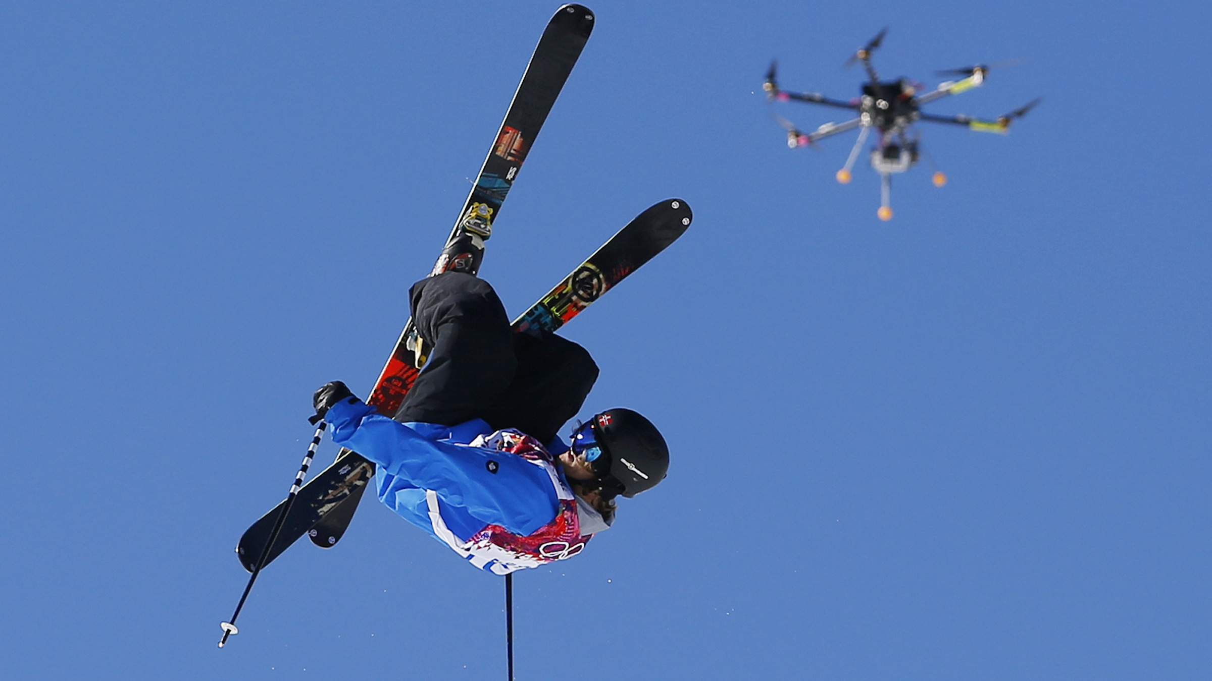 A drone camera follows Norway's Aleksander Aurdal during the men's ski slopestyle final at the Rosa Khutor Extreme Park, at the 2014 Winter Olympics, Thursday, Feb. 13, 2014, in Krasnaya Polyana, Russia. (AP Photo/Sergei Grits)