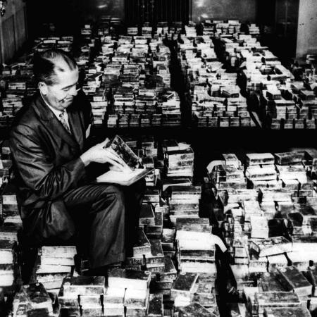 A member of the vault staff at the Federal Reserve Bank in New York inspects gold bricks in January 1965. at the Federal Reserve Bank in New York. Gold prices dropped Wednesday, Nov. 26, 1997, below $300 an ounce for the first time since 1985. Gold for December delivery fell $3.80 to $296.70 an ounce on the New York Mercantile, the second sharp drop in two days.