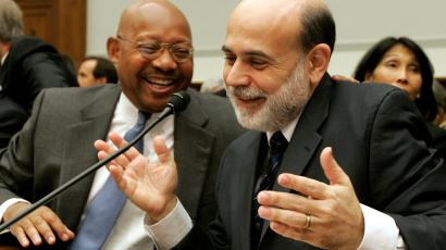 Chairman of the Federal Reserve Ben Bernanke, right, shares a laugh with Housing and Urban Development Secretary Alphonso Jackson, left, during a break in the House Financial Services Committee hearing, Thursday, Sept. 20, 2007, on the ongoing mortgage foreclosure problems.