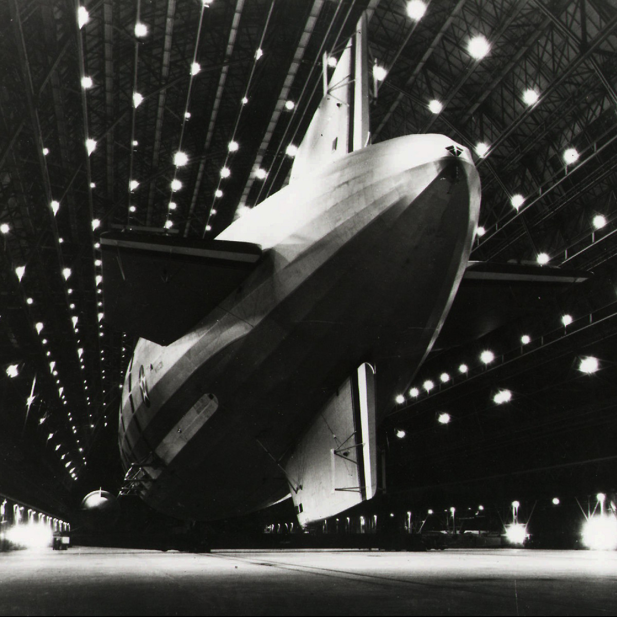 In this photo provided by the U.S. navy, the airship USS Macon is moored at Hangar One at Moffett Federal Airfield near Mountain View, Calif. The date is unknown.