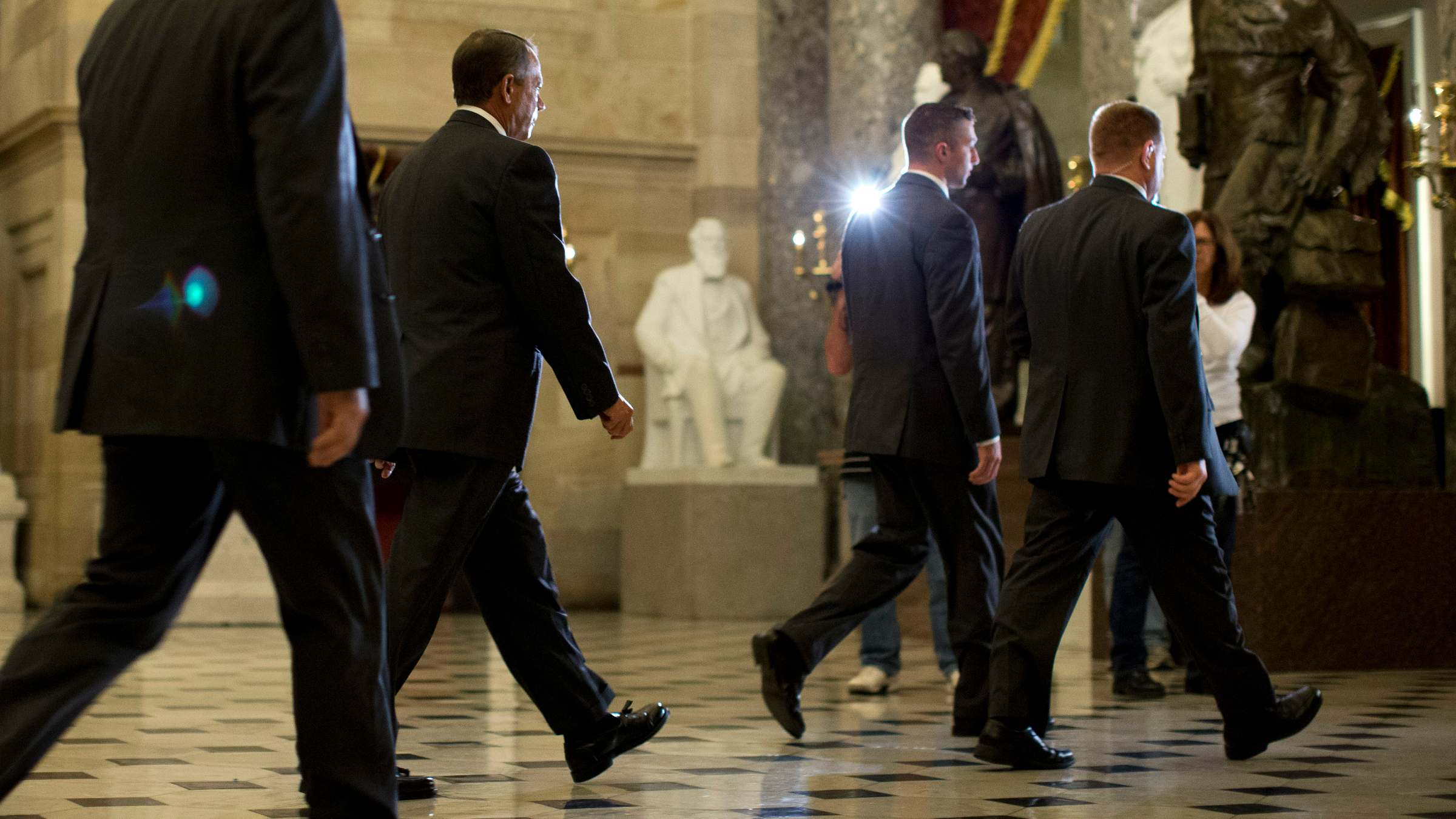 Speaker of the House Rep. John Boehner, R-Ohio, , second from left, walks to the House floor to vote on a bill to the raise the debt ceiling and fund the government on Capitol Hill on Wednesday, Oct. 16, 2013 in Washington.