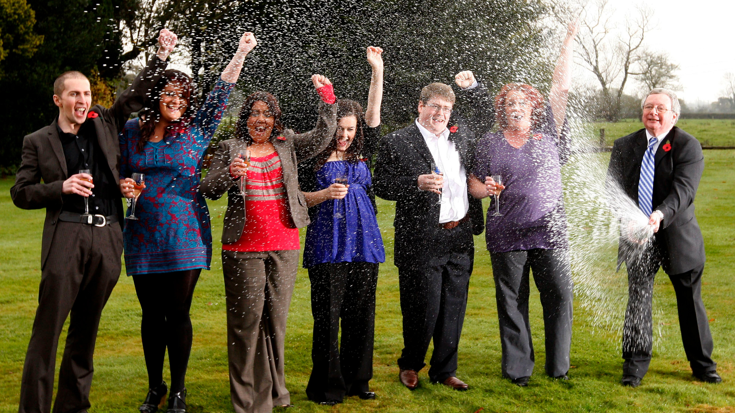Members of a syndicate of office workers celebrate winning 45.5 million pounds (US$76 million euro50.6 million) after winning a share of the UK's largest ever lottery prize in the Euromillions lottery at the village of Thornton Hough near Liverpool, England, Tuesday Nov. 10, 2009. The winners who work for Hewlett Packard are from the right, John Walsh, Donna Rhodes, James Bennett, Alex Parry, Ceri Scullion, Emma Cartwright and Sean Connor.