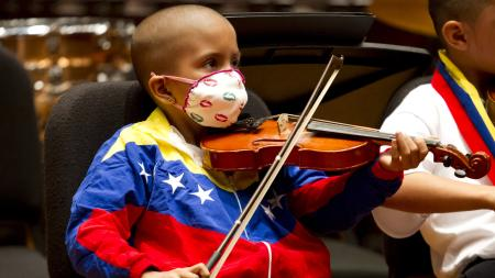 Sthefany Serrano, 6, a member of the Alma Llanera Hospital Care Program's orchestra for sick children, performs during their first anniversary concert in Caracas June 29, 2013. The program is one of the most recent initiatives of Venezuela's musical education program known as El Sistema, whose most famous alumnus is Gustavo Dudamel. The program teaches hospital-bound children to play musical instruments during their treatment. Picture taken June 29, 2013. REUTERS/Carlos Garcia Rawlins