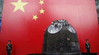 "The return module of the Shenzhou-9 is displayed during ""China's manned spacecraft"", at an exhibition related to Shenzhou-9 at Shanghai Science and Technology Museum in Shanghai November 2, 2012. REUTERS/Aly Song"