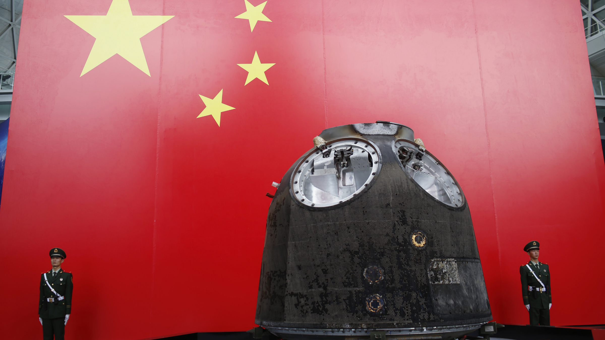 """The return module of the Shenzhou-9 is displayed during """"China's manned spacecraft"""", at an exhibition related to Shenzhou-9 at Shanghai Science and Technology Museum in Shanghai November 2, 2012. REUTERS/Aly Song"""