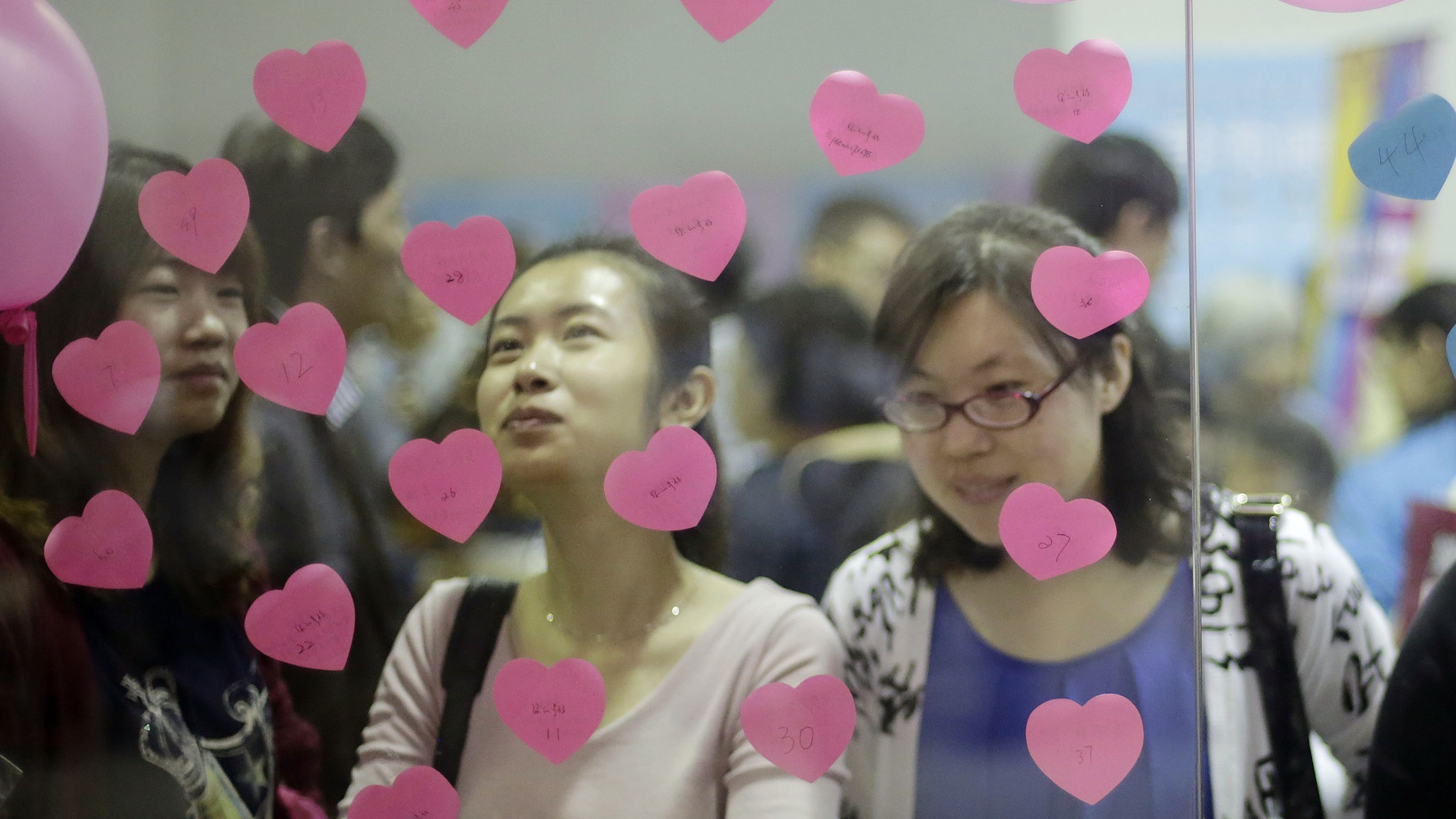 "Participants take part of a bachelor's meeting event on during a mass match-making event ahead of Singles Day in Shanghai, China, Saturday, Nov. 9, 2013. Singles Day was begun by Chinese college students in the 1990s as a version of Valentine's Day for people without romantic partners. The timing was based on the date Nov. 11, or ""11.11"" — four singles. (AP Photo/Eugene Hoshiko)"