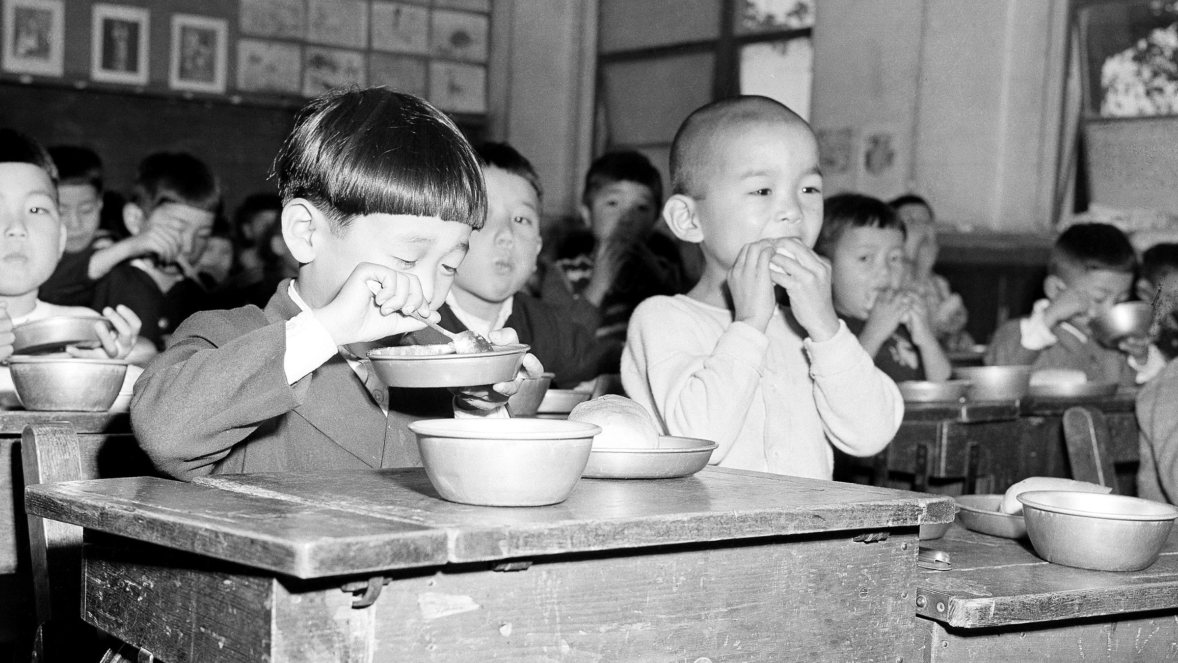 At their desks in classroom, children eat their lunch, furnished through UNICEP - United Nations International Children's Emergency Fund - in Japan on Jan. 5, 1952. (AP Photo/Yuichi Jackson Ishizaki)