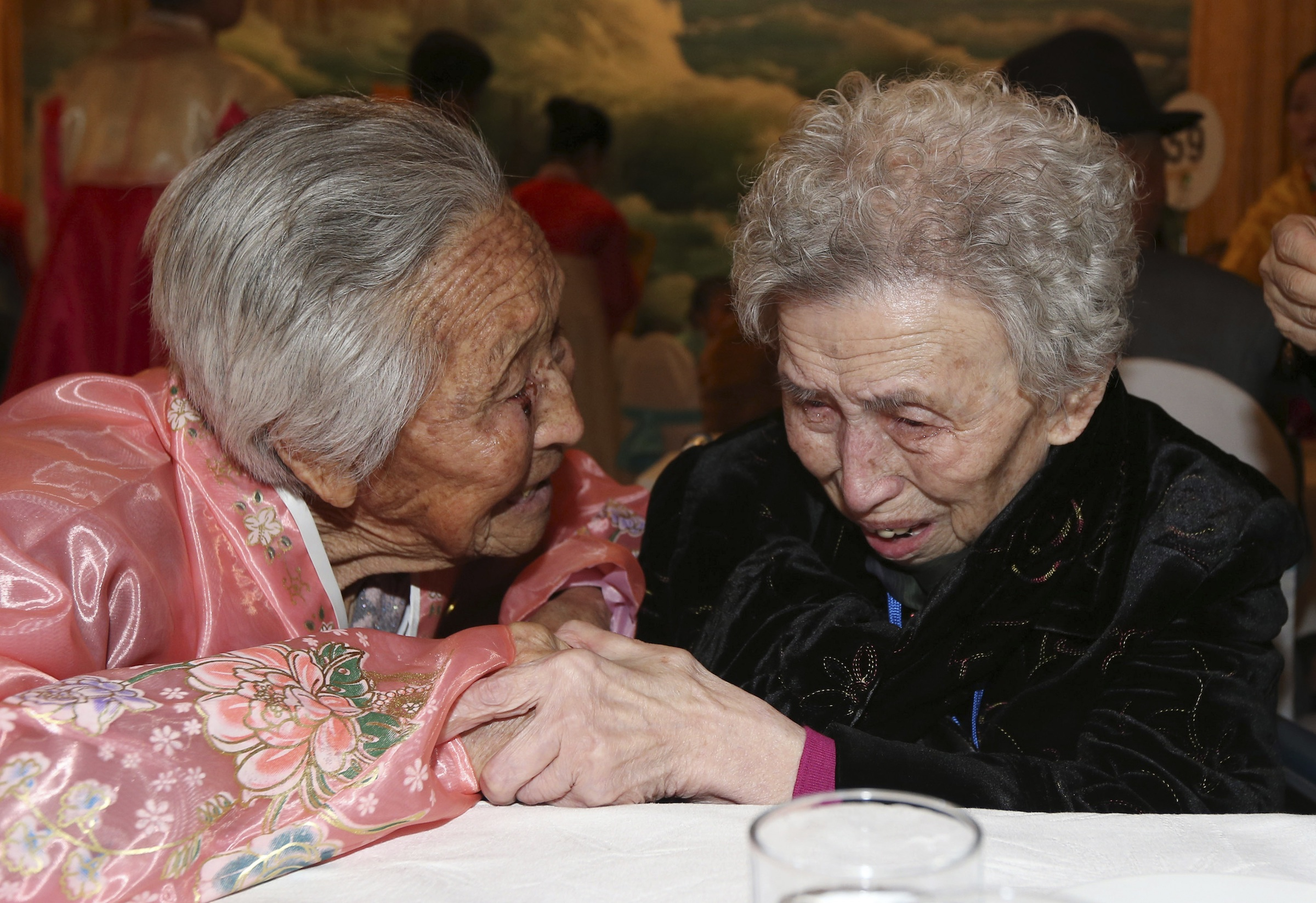 South Korean Lee Young-shil, 87, right, meets with her North Korean sister Lee Jong Shil, 84, during the Separated Family Reunion Meeting at Diamond Mountain resort in North Korea, Thursday, Feb. 20, 2014. (AP Photo/Yonhap, Lee Ji-eun) Korea Out