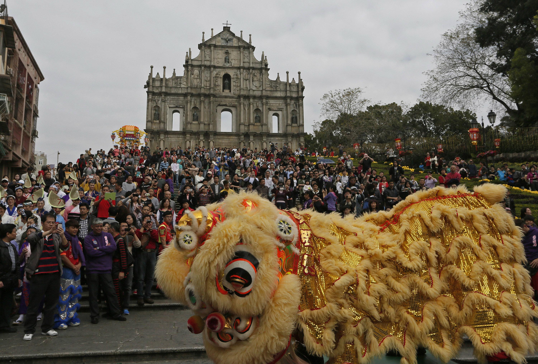 Macau's ruin of St. Paul's, with lion dance.