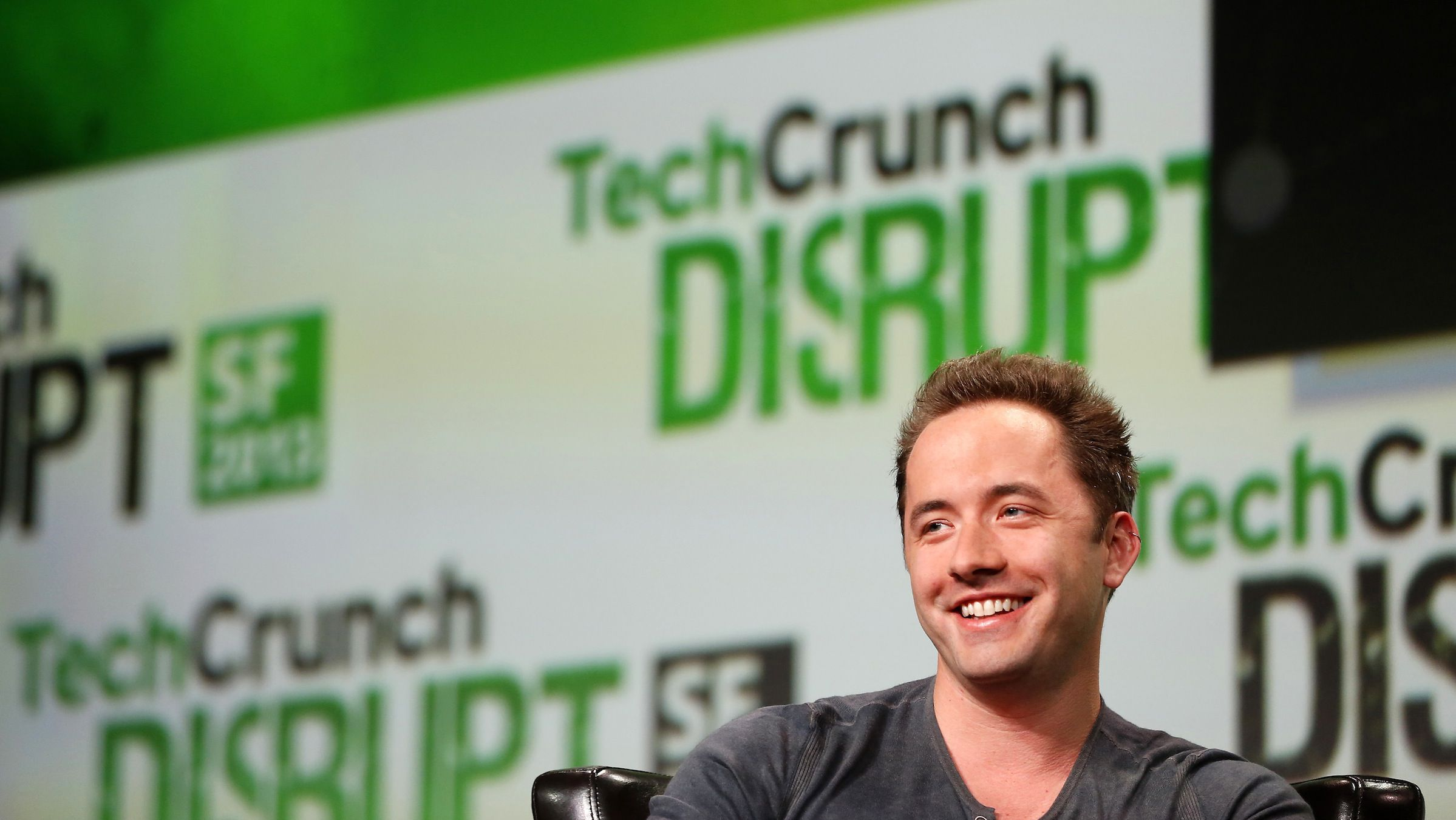 Drew Houston, CEO and Co-Founder of Dropbox, speaks on stage during a fireside chat session at TechCrunch Disrupt SF 2013 in San Francisco, California September 9, 2013. REUTERS/Stephen Lam (UNITED STATES - Tags: BUSINESS SCIENCE TECHNOLOGY) - RTX13ESW