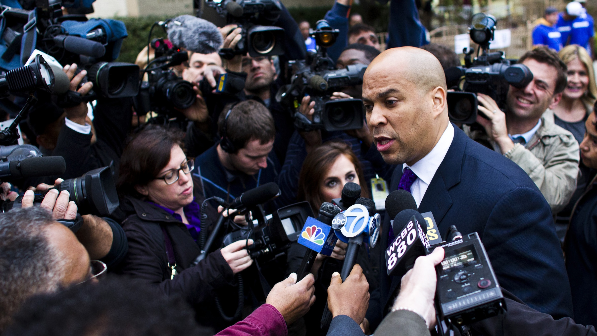 Newark Mayor and U.S. Senate candidate Cory Booker speaks with members of the media before casting his ballot during the Senate primary election in Newark, New Jersey, October 16, 2013. Booker, the charismatic mayor of New Jersey's largest city, is heavily favored to beat conservative activist Steve Lonegan when voters head to the polls on Wednesday in a special election to fill New Jersey's vacant U.S. Senate seat. REUTERS/Eduardo Munoz (UNITED STATES - Tags: POLITICS ELECTIONS) - RTX14DPK