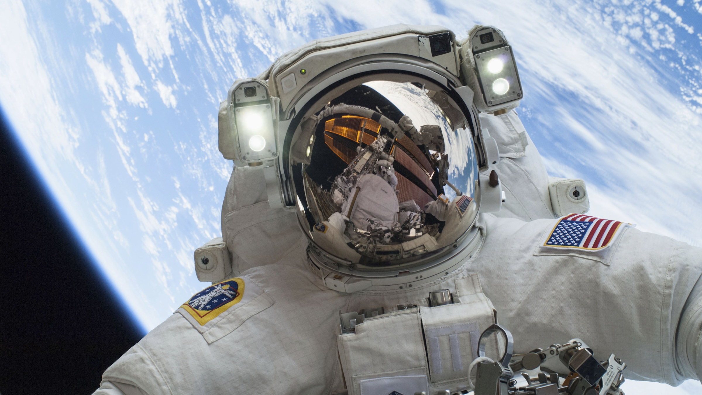 Astronaut Mike Hopkins, Expedition 38 Flight Engineer, is shown in this handout photo provided by NASA as he participates in the second of two spacewalks which took place on December 24, 2013, released on December 27, 2013. The scheduled spacewalks were designed to allow the crew to change out a faulty water pump on the exterior of the Earth-orbiting International Space Station. He was joined on both spacewalks by NASA astronaut Rick Mastracchio, whose image shows up in Hopkins' helmet visor. REUTERS/NASA/Handout via Reuters  (UNITED STATES - Tags: SCIENCE TECHNOLOGY TPX IMAGES OF THE DAY) ATTENTION EDITORS - THIS IMAGE WAS PROVIDED BY A THIRD PARTY. FOR  EDITORIAL USE ONLY. NOT FOR SALE FOR MARKETING OR ADVERTISING CAMPAIGNS. THIS PICTURE IS DISTRIBUTED EXACTLY AS RECEIVED BY REUTERS, AS A SERVICE TO CLIENTS - RTX16V24