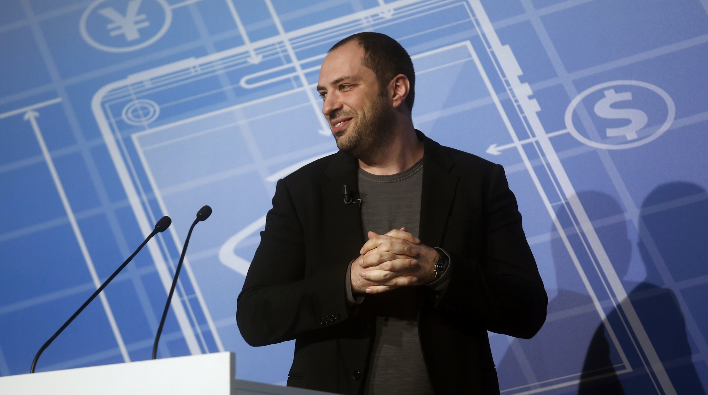 WhatsApp Chief Executive Officer and co-founder Jan Koum delivers a keynote speech at the Mobile World Congress  in Barcelona February 24, 2014. The world's biggest messaging service WhatsApp, which Facebook has just bought for $19 billion, will add voice calls to its product in the second quarter of this year, its chief executive Koum said on Monday. REUTERS/Albert Gea (SPAIN - Tags: BUSINESS TELECOMS) - RTX19EGG