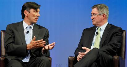 Chairman and CEO of AOL Tim Armstrong (L) speaks to Chairman and CEO of Time Warner Cable Glenn Britt during a panel session at The Cable Show in Boston, Massachusetts May 21, 2012.