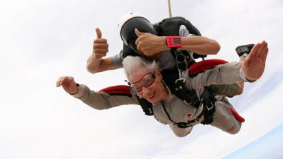 """Jean Pettit, an 84-year-old resident of Freedom Plaza, a Brookdale Senior Living continuing care retirement community in Peoria, Ariz., won the fulfillment of her Experience of a Lifetime - to skydive. """"This was one of the most amazing experiences of my life so far,"""" said Pettit. Pettit won this opportunity through Brookdale's Experiences of a Lifetime program, in which residents are invited to submit their wishes, and the company helps make selected experiences come true. (PRNewsFoto/Brookdale Senior Living, Inc."""