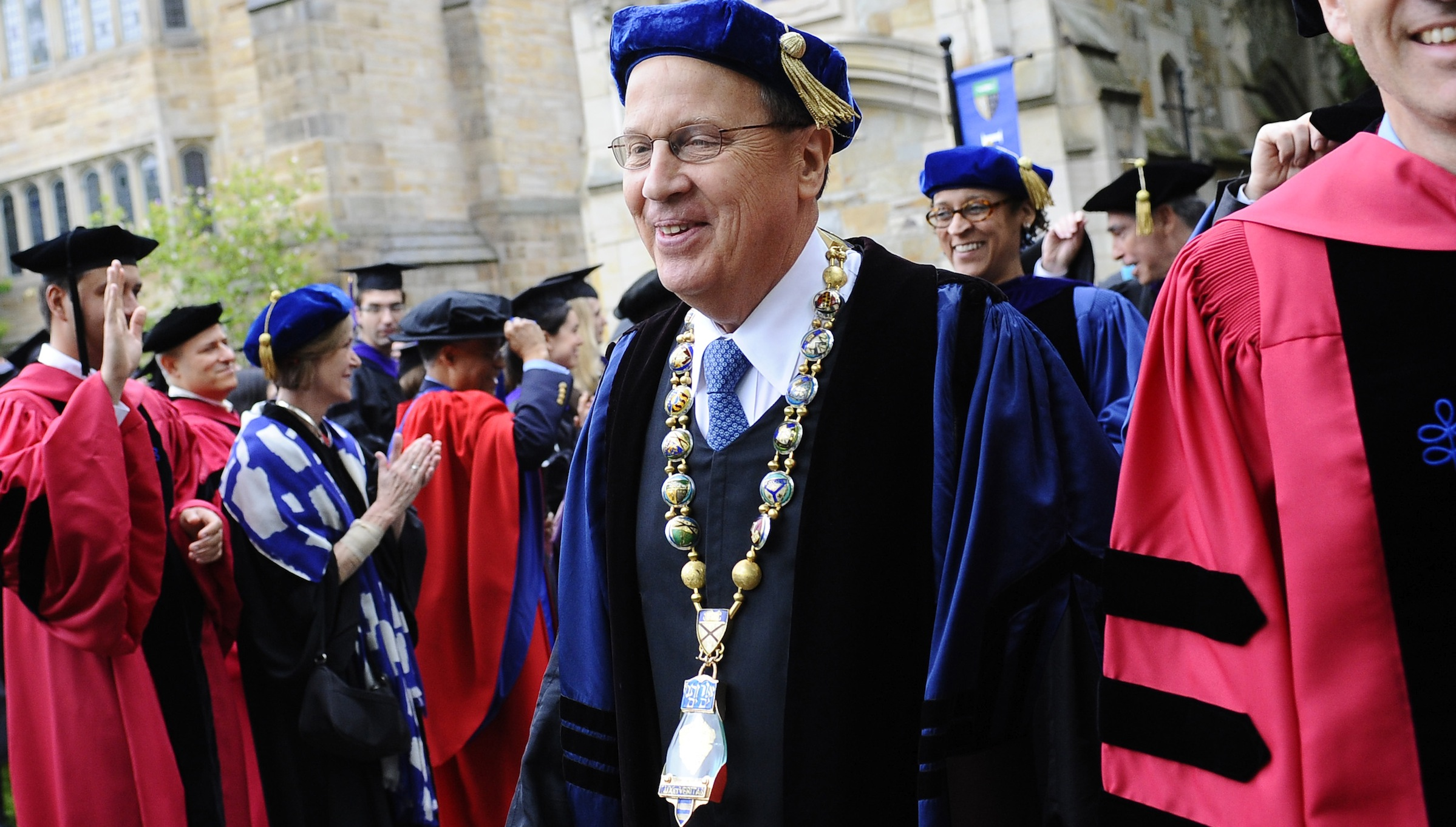 Yale President Richard Levin smiles as he walks in his final procession during commencement at Yale University in New Haven, Conn., Monday, May 20, 2013. Levin is retiring June 30th. (AP Photo/Jessica Hill)