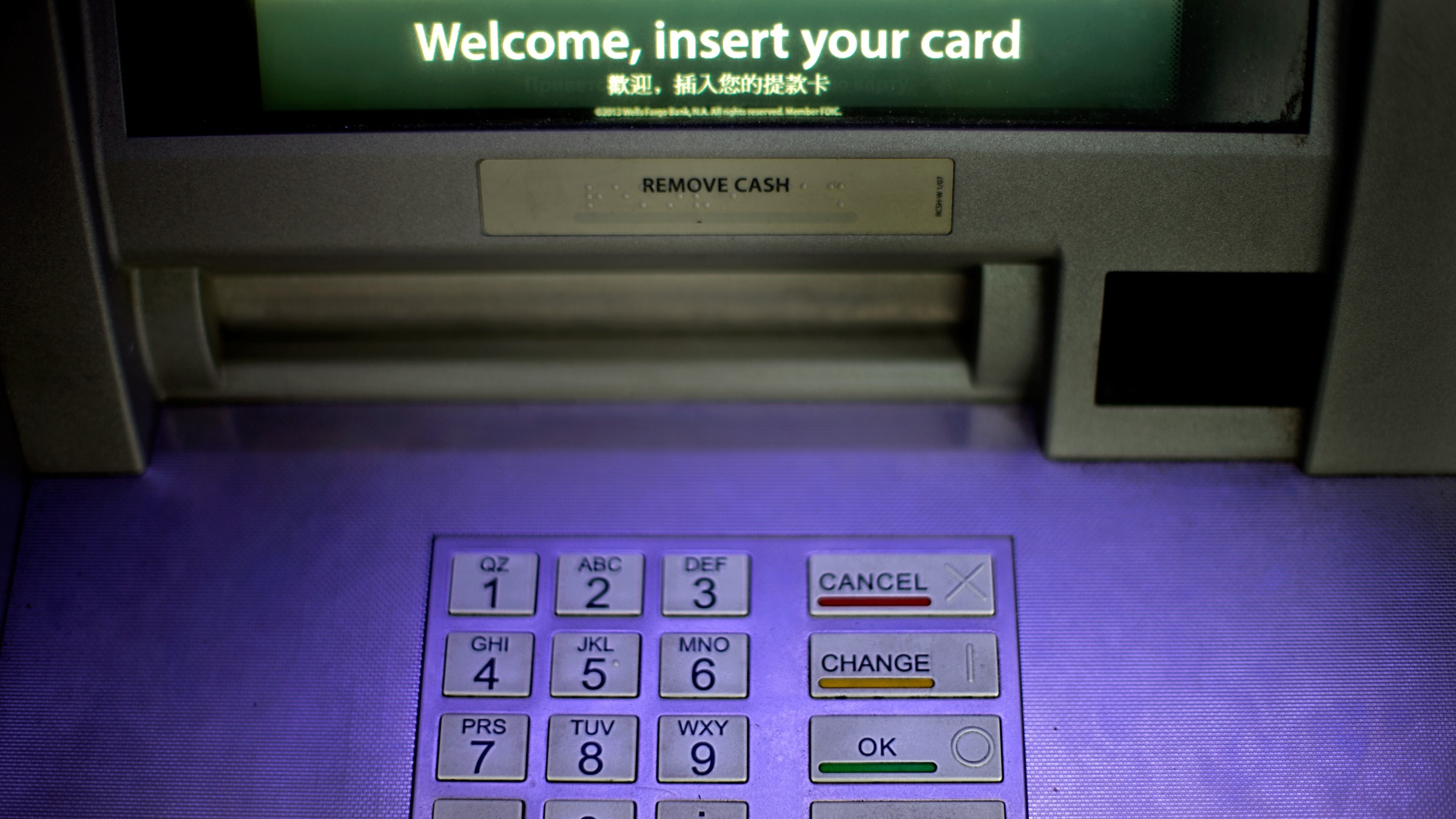 """An ATM is displayed at a Wells Fargo bank, Tuesday, July 16, 2013, in Atlanta. Banks large and small are girding for an elaborate drill this week that will test how they'd fare if hackers unleashed a powerful and coordinated attack against them. The exercise is being called """"Quantum Dawn 2,"""" and if the name sounds like a video game, it's also meant to convey the seriousness of a big threat. (AP Photo/David Goldman)"""