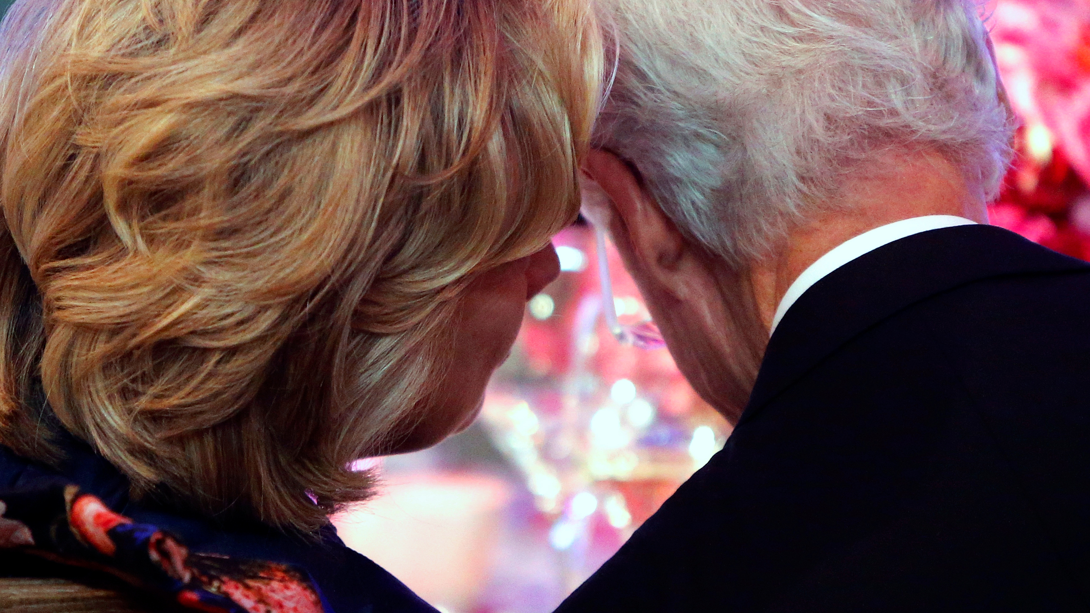 Former Secretary of State Hillary Clinton (L) and her husband, former U.S. President Bill Clinton talk at a dinner in honor of Presidential Medal of Freedom awardees at the Smithsonian National Museum of American History in Washington, November 20, 2013.