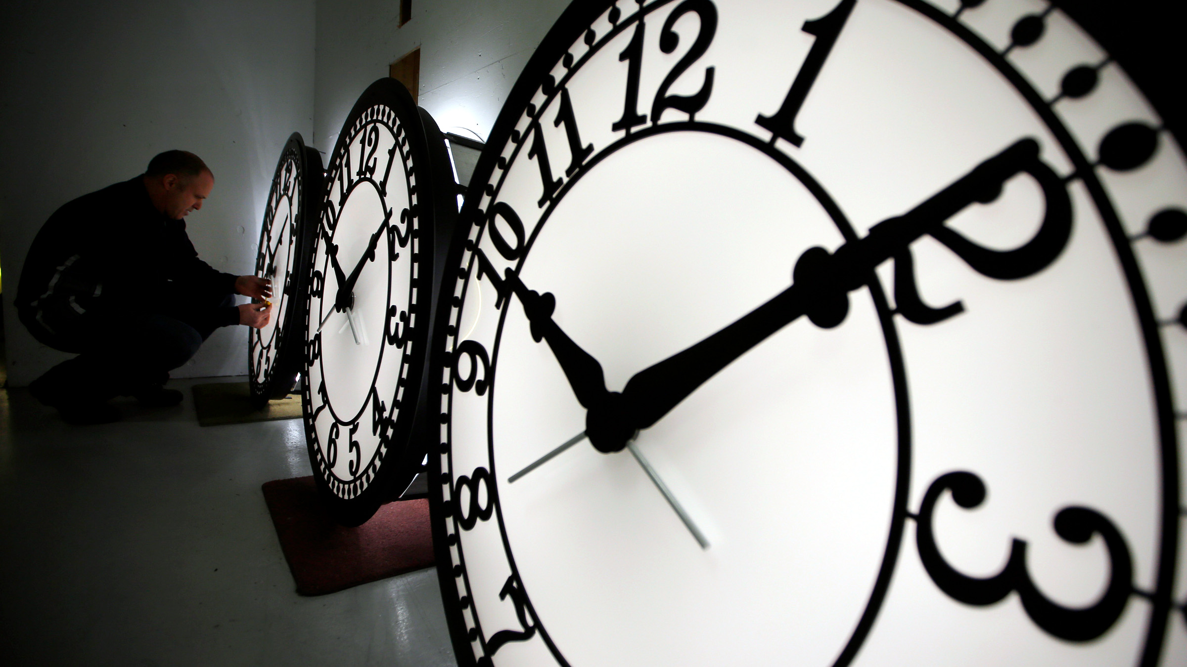 Peter Shugrue checks one of four custom, flush mounted clocks, destined for installation in Kansas City, Missouri, at the Electric Time Company factory in Medfield, Massachusetts March 8, 2013. Daylight saving time begins in the United States at 02:00 AM March 10.