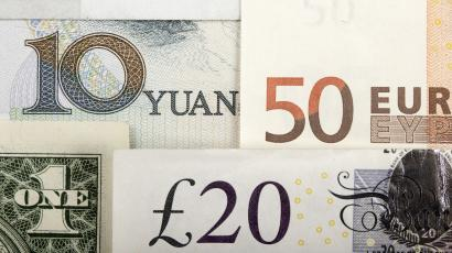 Arrangement of various world currencies including Chinese Yuan, US Dollar, Euro, British Pound, pictured in Warsaw, January 25, 2011 REUTERS/Kacper Pempel