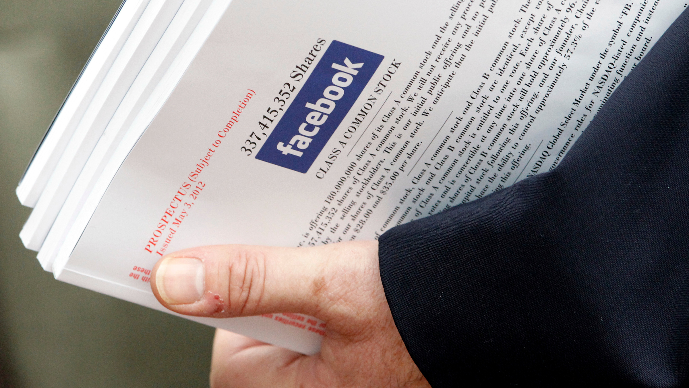An investor holds prospectus explaining the Facebook stock after attending a show for Facebook Inc's initial public offering at the Four Season's Hotel in Boston, Massachusetts May 8, 2012. Facebook Inc CEO Mark Zuckerberg took questions in New York about the No. 1 social network's slowing revenue growth and its $1 billion Instagram purchase, kicking off a cross-country roadshow on Monday to promote its $10 billion initial public offering.