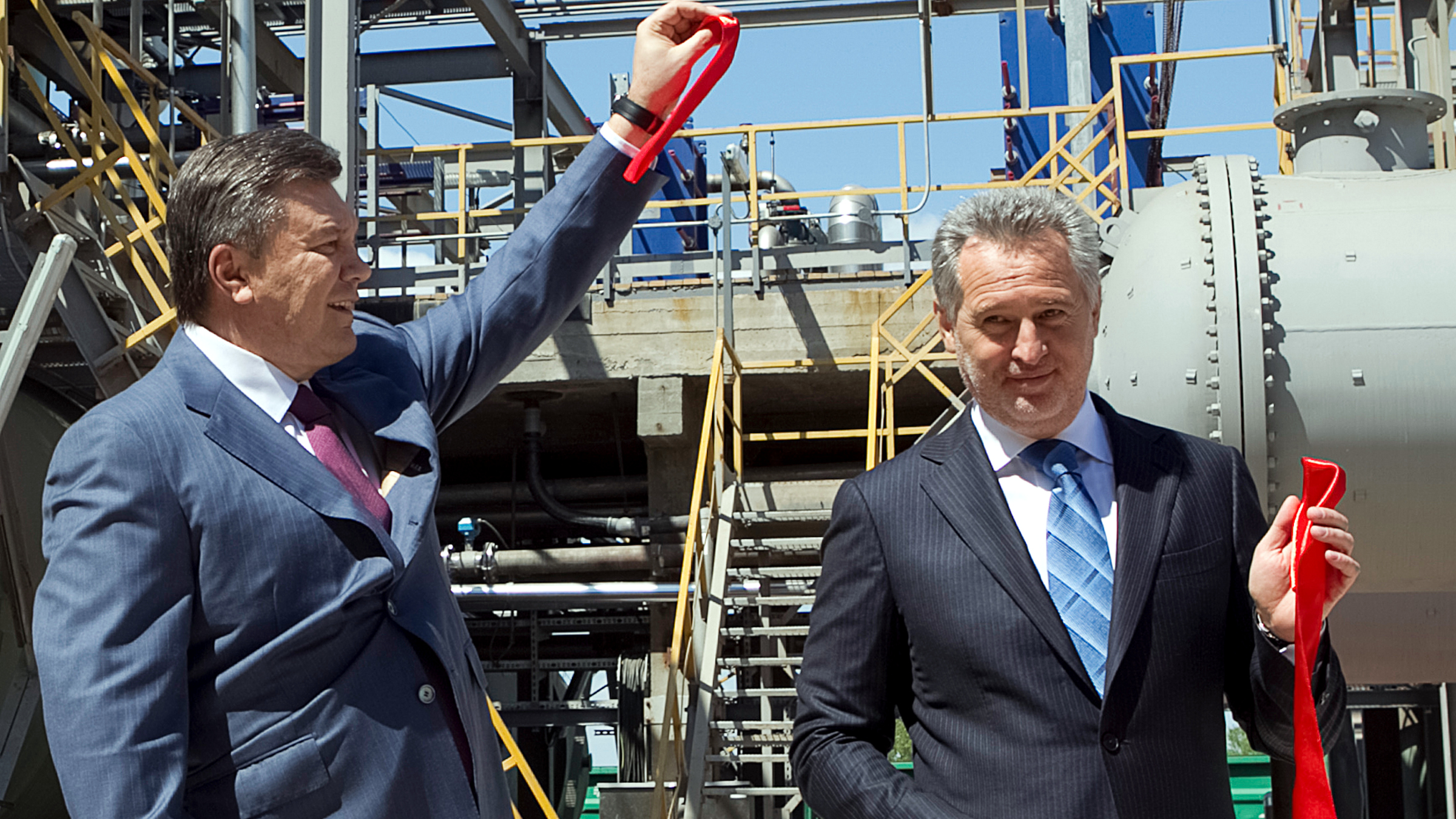 Dmytro Firtash, one of Ukraine's richest men, (R) and Ukrainian President Viktor Yanukovich take part in an opening ceremony of a new complex for the production of sulfuric acid in Crimea region April 27, 2012. Austria has arrested Ukrainian businessman Firtash at the request of the United States which has been investigating him since 2006, government sources said. The Federal Crime Agency on March 13, 2014 identified the suspect only as Dmitry F., 48, but government sources said it was Firtash. The agency said he was suspected of violating laws on bribery and forming a criminal organisation in the course of foreign business deals. Picture taken April 27, 2012.