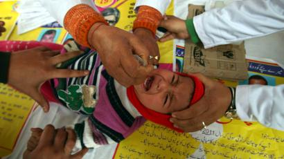 A child receives polio drops during a polio eradication programme in Jammu February 19, 2012. The polio eradication programme in India aims to immunize every child under five years of age with the oral polio vaccine.