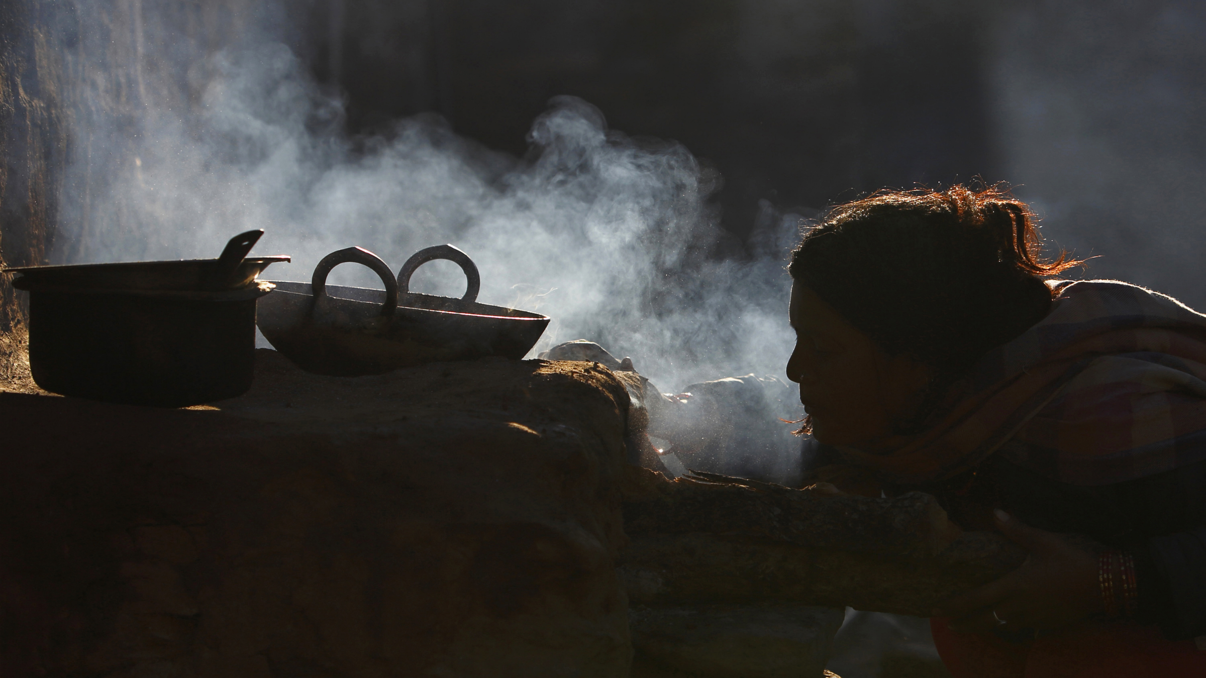 A woman uses firewood to cook food at Sapay, Achham in the Far-Western region of Nepal, around 900 km (559 miles) from Kathmandu February 17, 2014. REUTERS/Navesh Chitraka