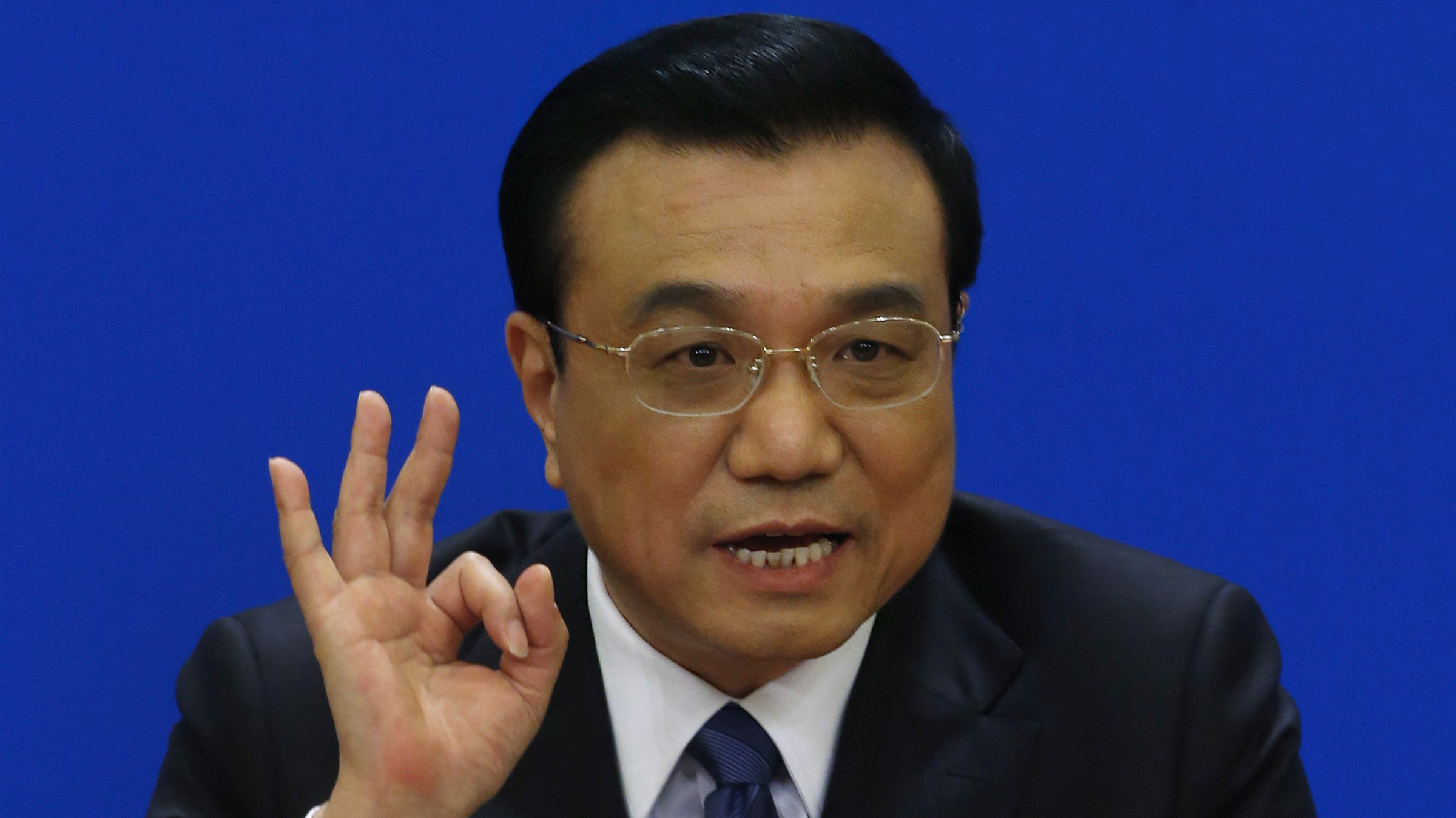 China's Premier Li Keqiang gestures as he speaks during a news conference, after the closing ceremony of the Chinese National People's Congress (NPC) at the Great Hall of the People, in Beijing, March 13, 2014. REUTERS/Barry Huang