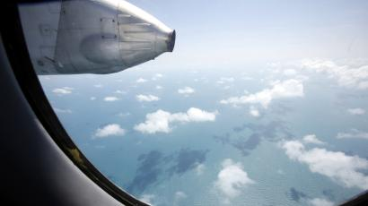 """Clouds hover outside the window of a Vietnam Air Force search and rescue aircraft An-26 on a mission to find the missing Malaysia Airlines flight MH370, off Vietnam's Tho Chu island March 10, 2014. The disappearance of a Malaysian airliner about an hour into a flight to Beijing is an """"unprecedented mystery"""", head of Malaysia's Civil Aviation Authority Azharuddin Abdul Rahman said on Monday, as a massive air and sea search now in its third day failed to find any trace of the plane or 239 people on board."""