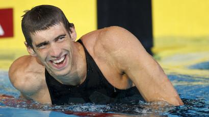 US swimmer Michael Phelps smiles as he leaves the pool after setting a new world record in the men's 100m butterfly event at the USA Swimming National Championships in Indianapolis, Indiana, July 9, 2009