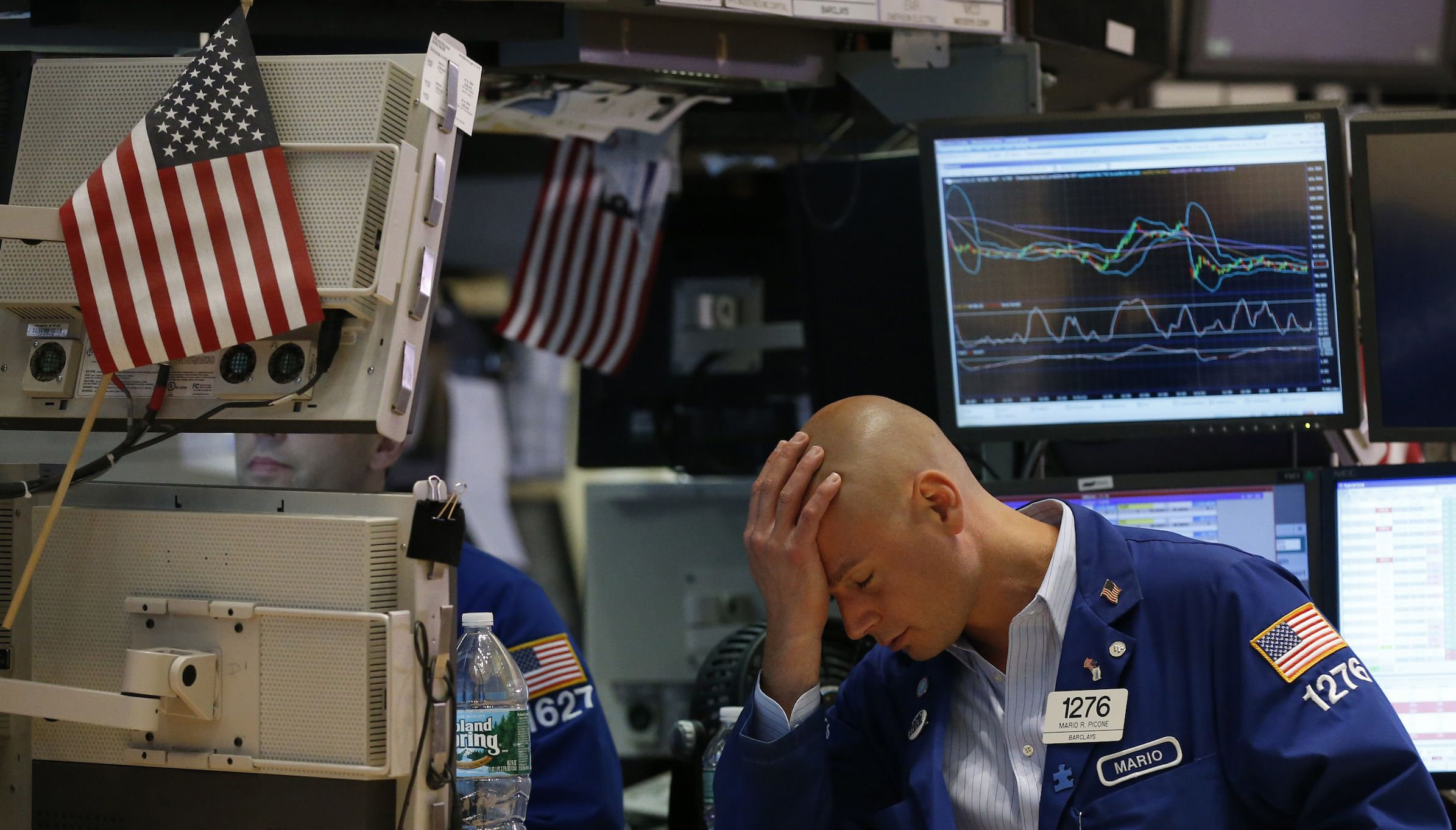 Trader Mario Picone works on the floor of the New York Stock Exchange June 1, 2012.  REUTERS/Brendan McDermid (UNITED STATES - Tags: BUSINESS TPX IMAGES OF THE DAY) - RTR32YRX
