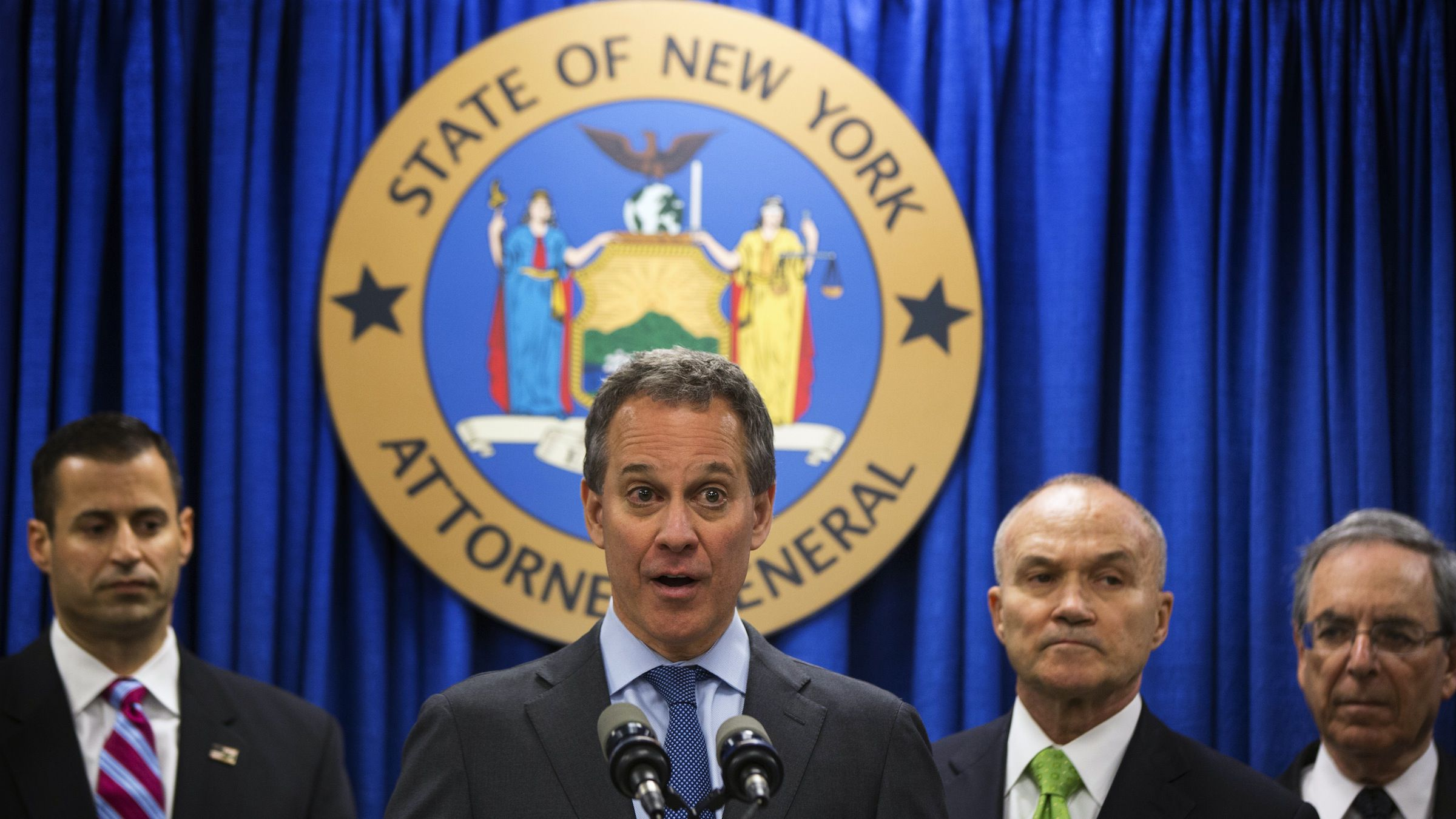 New York Attorney General Eric Schneiderman (C) speaks at a news conference announcing an organized crime task force take down of an unstamped cigarette trafficking ring in New York, May 16, 2013. New York authorities on Thursday announced the arrest of 16 people in a cigarette smuggling ring that included three men who had been under scrutiny because of suspected links to Islamic militant groups, a law enforcement official said. REUTERS/Lucas Jackson (UNITED STATES - Tags: CRIME LAW) - RTXZPMY