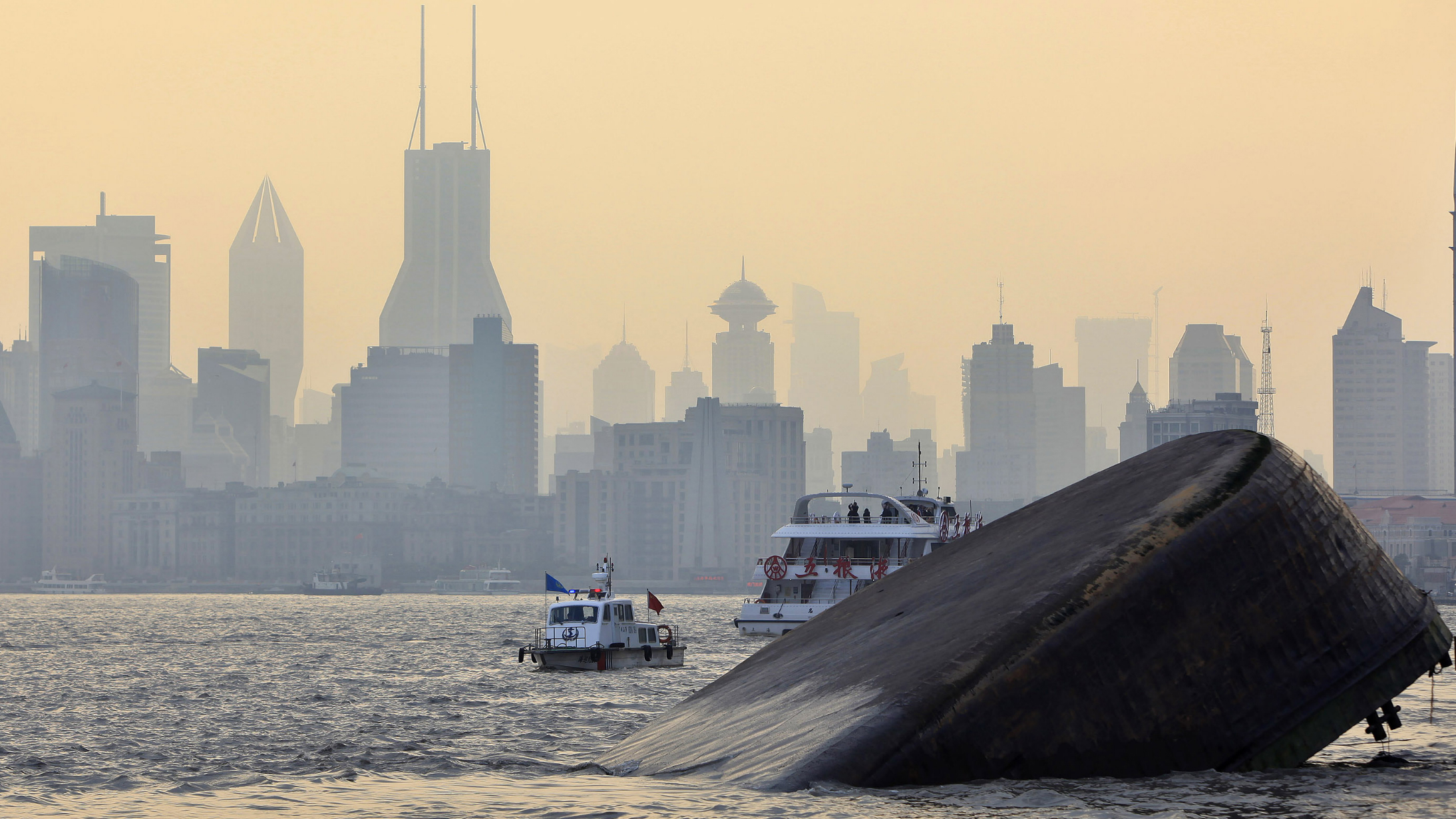 A view shows a cargo ship after it collided with a boat on Huangpu River in Shanghai February 1, 2010. Three sailors were rescued from the accident, while further investigation is underway, according to local media. REUTERS/Aly Song