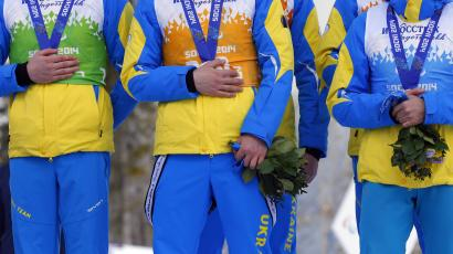 Ukraine's athletes cover their silver medals with hands after finishing second in cross country 4x2.5km open relay at the 2014 Winter Paralympic, Saturday, March 15, 2014, in Krasnaya Polyana, Russia. The majority of Ukraine's Paralympic medalists covered their medals during medal ceremonies. (AP Photo/Dmitry Lovetsky)