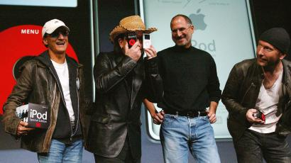 October 26, 2004U2 lead singer Bono jokes as he stands with Apple CEO Steve Jobs and U2 guitarist The Edge during a news conference in San Jose.