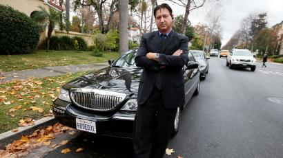 Transportation app Uber driver Shuki Zanna, 49, poses in front of his limousine in Beverly Hills, California, December 19, 2013. Uber has entered more than 60 markets, ranging from its hometown of San Francisco to Berlin to Tokyo. Leaked financials in December indicate that the company, which began connecting passengers with drivers of vehicles for hire about 3-1/2 years ago, is generating $200 million a year in revenue beyond what it pays to drivers. Photo taken December 19, 2013.