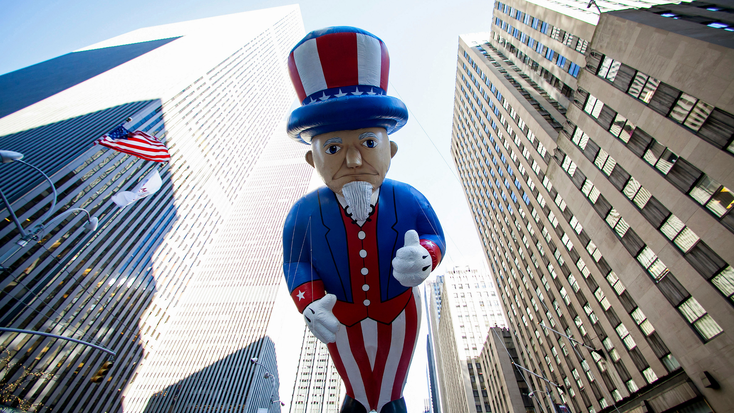 An Uncle Sam balloon floats down Sixth Avenue during the 87th Macy's Thanksgiving Day Parade in New York November 28, 2013.