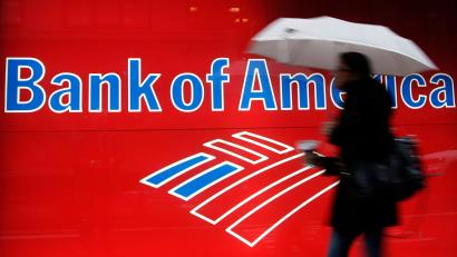 Woman passes Bank of America sign