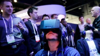 Man wears virtual reality Googles at a technology exposition
