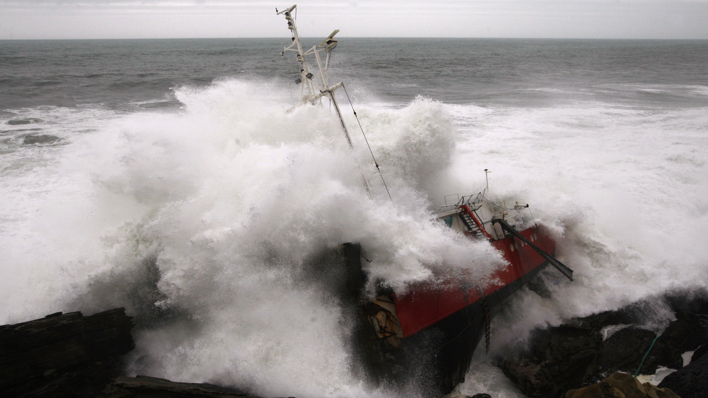 A wave crashes against the hull of the merchant ship Maro, wrecked near the Basque port town of Hondaribbia in the Bay of Biscay, March 11, 2008. The ship ran aground and was broken into three pieces by storm force winds and waves that have sunk numerous boats and caused extensive damage in the Biscay area. REUTERS/Vincent West