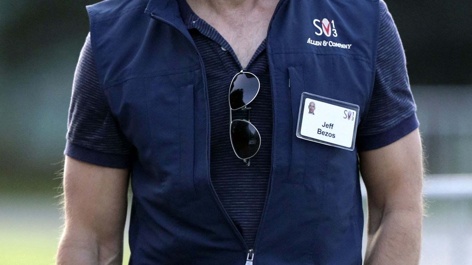 Jeffrey Bezos, founder and CEO of Amazon.com, Inc. walks to the morning session at the Allen & Company Sun Valley Conference in Sun Valley, Idaho, Wednesday, July 10, 2013. (AP Photo/Rick Bowmer)