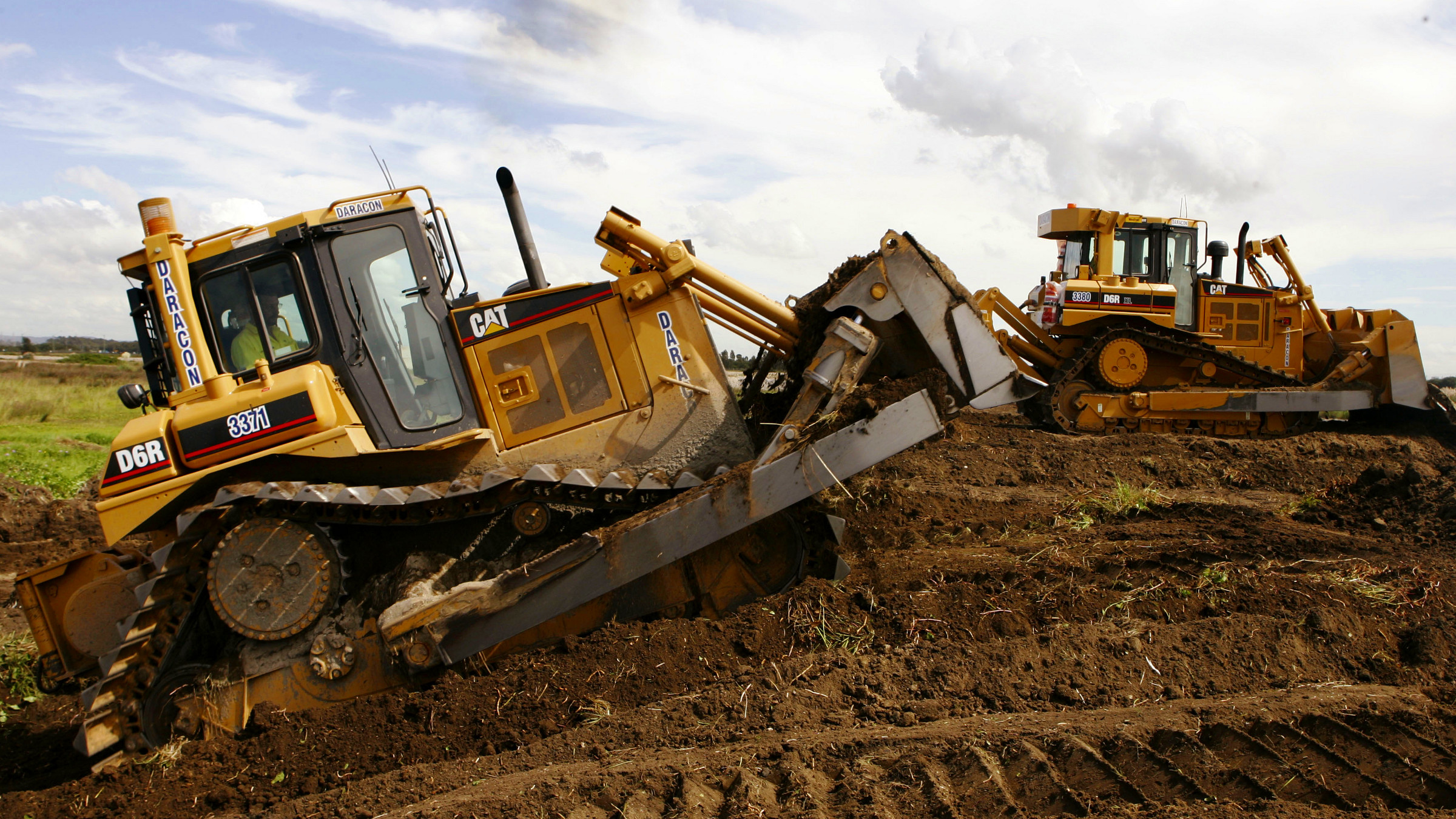 FILE - In this March 19, 2008 file photo, a pair of Caterpillar D6 bulldozers work on construction of a coal loading facility in Newcastle, Australia. Caterpillar Inc. said Tuesday, Oct. 20, 2009, its profit plunged in the latest quarter as construction companies bought fewer of its big yellow-and-black machines.