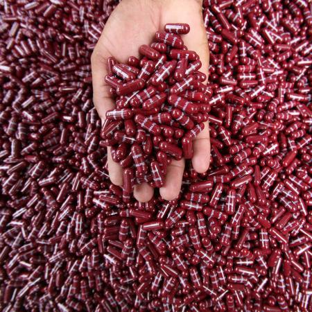 A police officer displays seized Parvon Spas capsules, a type of analgesic and anti-spasmodic, in Jammu July 28, 2009. Police said on Tuesday their men recovered 20,000 capsules from three drug peddlers during a routine search at a police check post on the outskirts of Jammu.