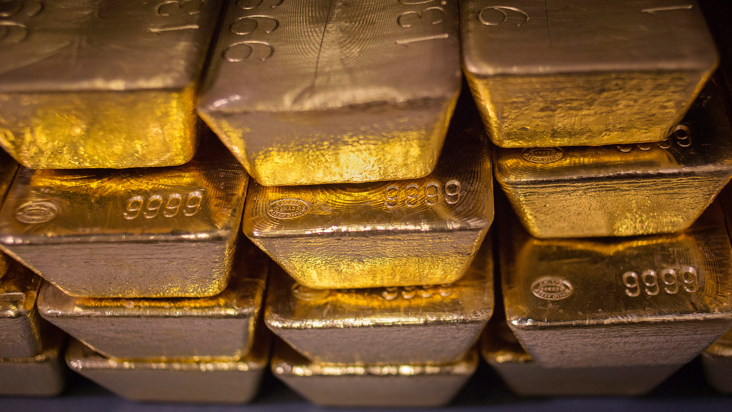 """Twenty four karat gold bars are seen at the United States West Point Mint facility in West Point, New York June 5, 2013. Demand for U.S. gold coins is still at """"unprecedented"""" high levels almost two months after an historic sell-off in gold released years of pent-up demand from retail investors, the head the U.S. Mint said on Wednesday."""