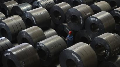 An employee works inside a steel export factory in Taiyuan, Shanxi province, April 10, 2013. China saw a mild trade deficit of $884 million in March as a forecast-busting 14.1 percent year on year surge in imports eclipsed export growth of 10 percent, signalling that domestic demand was gathering steam needed to drive economic recovery. REUTERS/Jon Woo