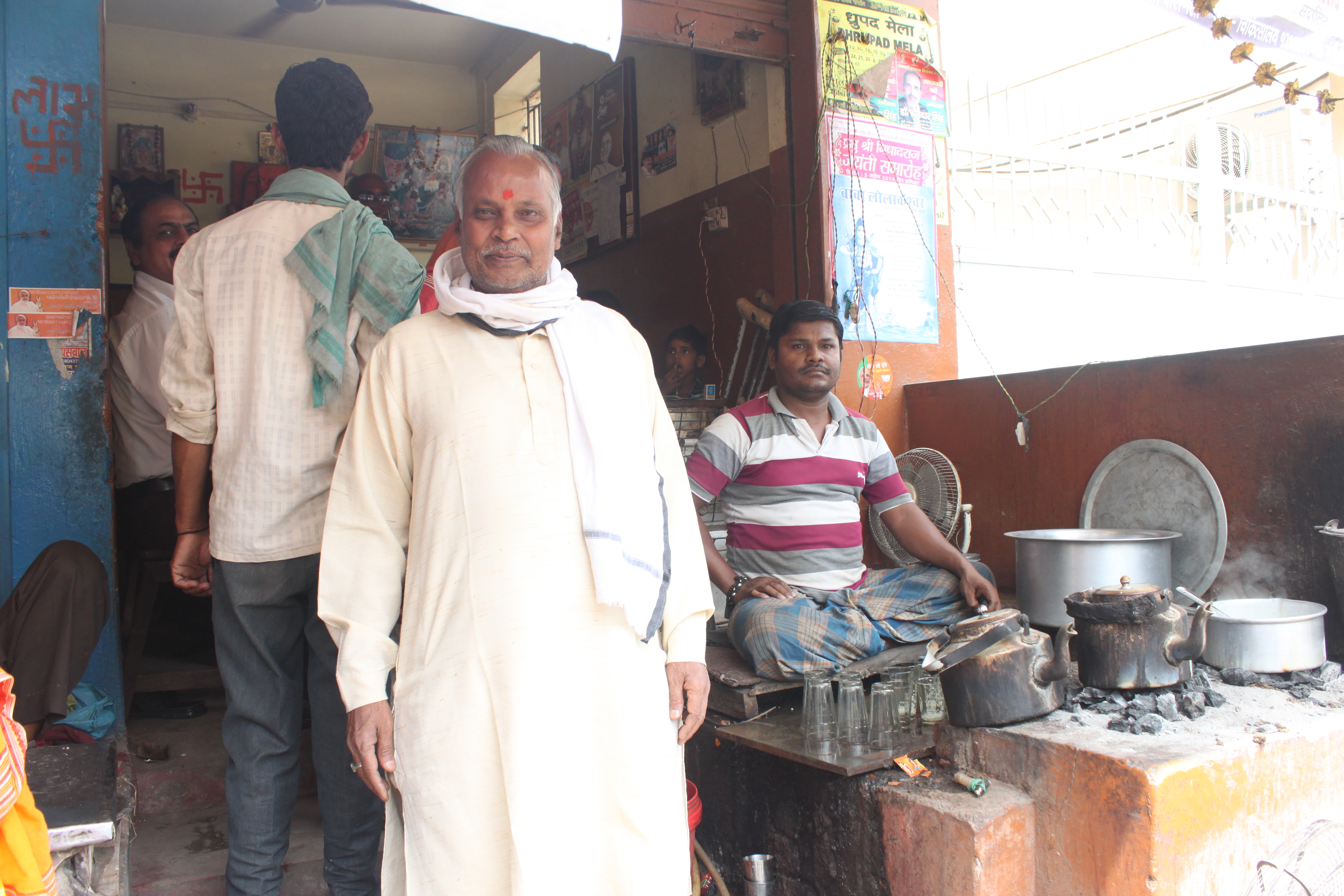 Pappu in front of his tea shop.