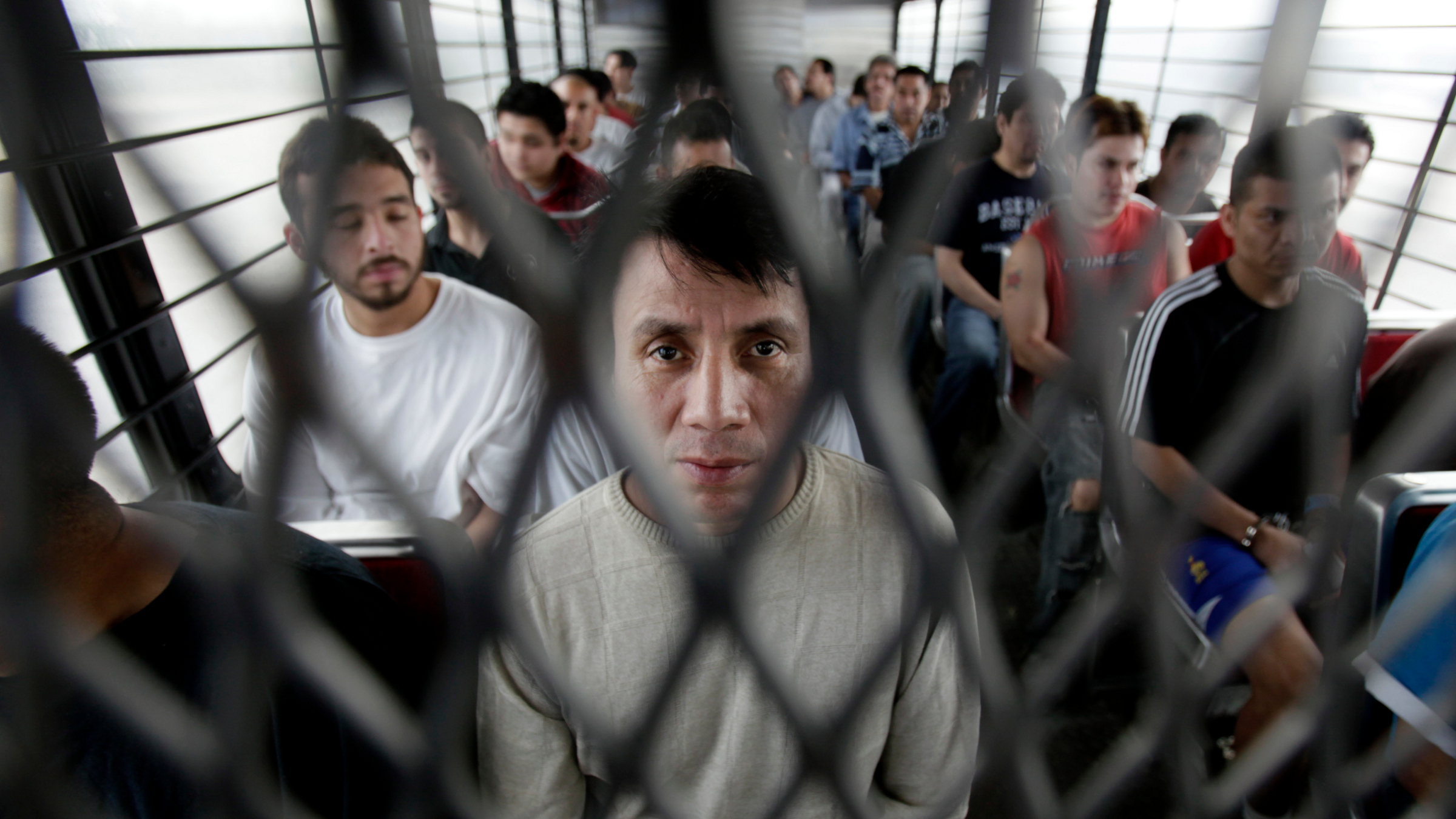Mexican immigrant Bernardo Ortega Guerrero sits on a deportation buss in Texas in Chicago, Il., Wednesday, May 26, 2010.