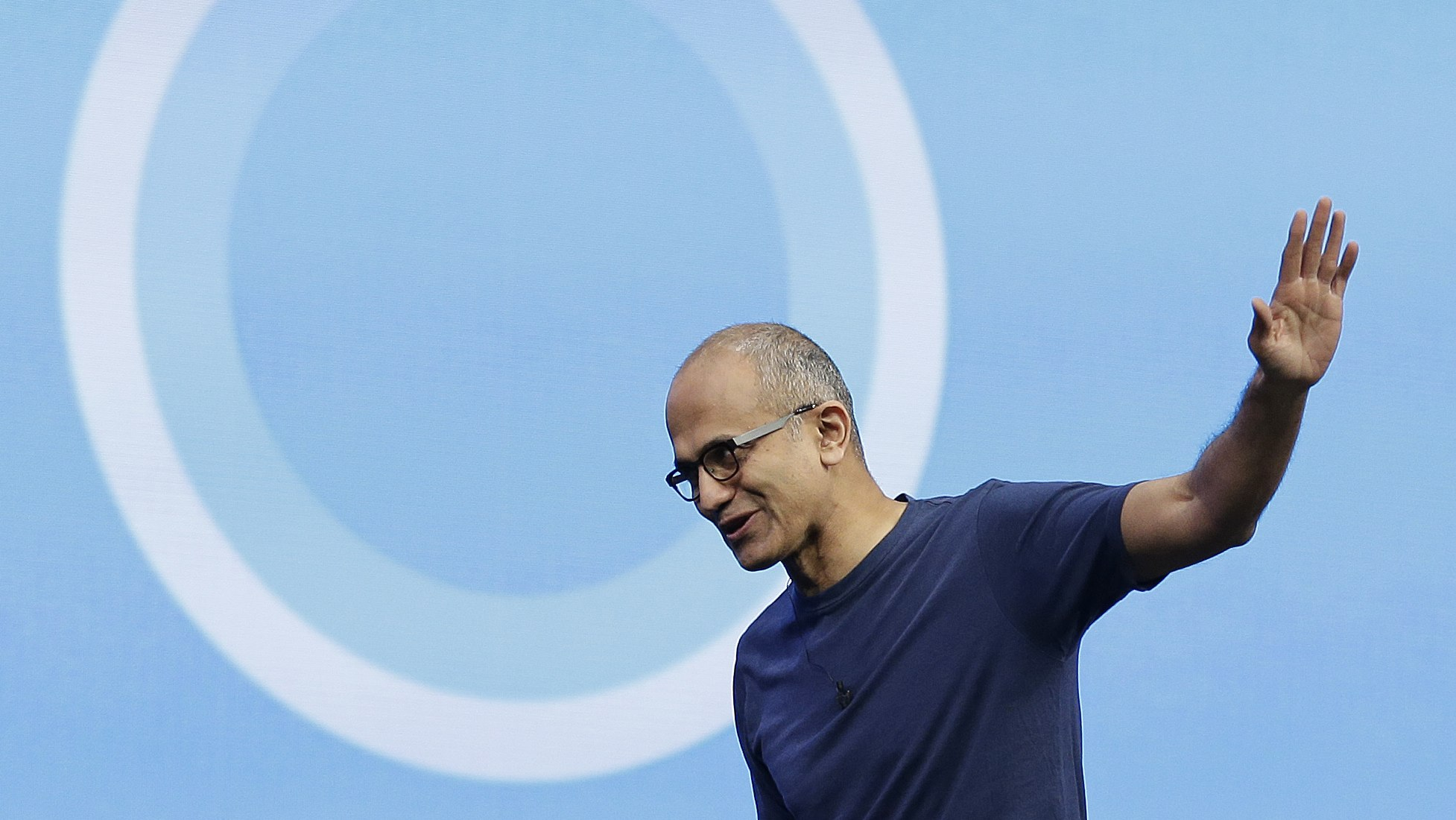 Microsoft CEO Satya Nadella waves after delivering the keynote address to the Build Conference Wednesday, April 2, 2014, in San Francisco. Microsoft kicked off its annual Build conference for software developers, with new updates to the Windows 8 operating system and upcoming features for Windows Phone and Xbox. (AP Photo/Eric Risberg)